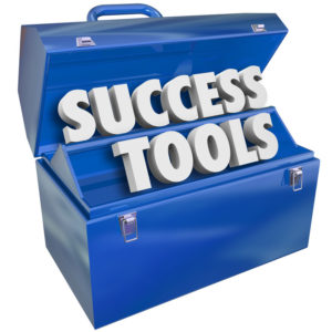 Success Tools words in a blue metal toolbox to illustrate learning new skills to achieve your goals in your job, career or life 17390938