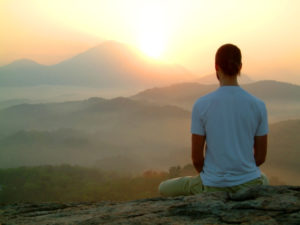 man meditating during sunrise 0126977